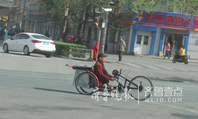 菏泽一男子下肢瘫痪,自制太阳能轮椅打算游遍全国