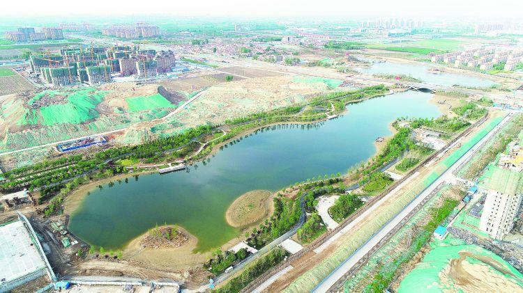 高新区猪龙河畔惬意美景俩月后绽放