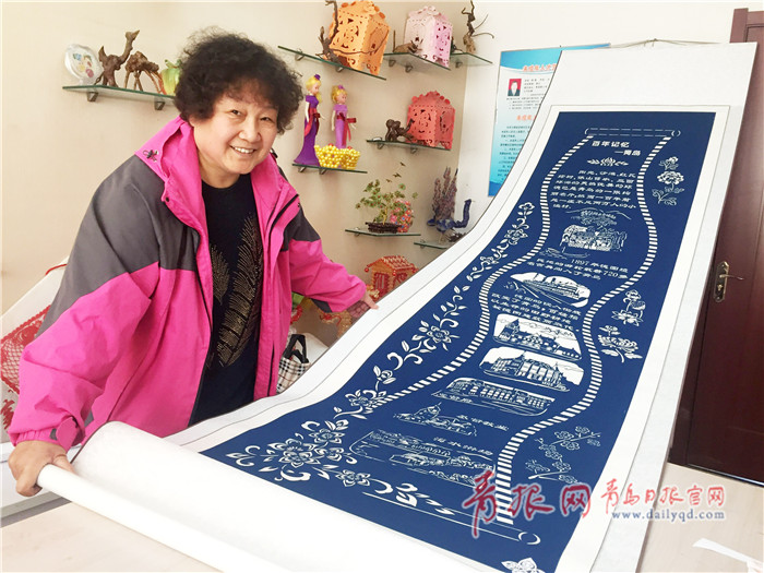 剪纸达人将青岛百年历史记录纸上 构图精巧形象生动