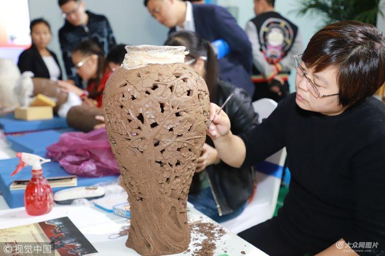第七届文博会:非物质文化遗产与现代科技唱主角