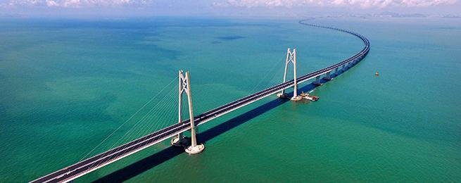 """人民时评:一桥通三地,发展趁""""涨潮"""""""