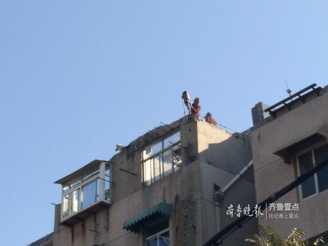 挨家挨户做工作,济南二七新村街道拆除21处高空违建
