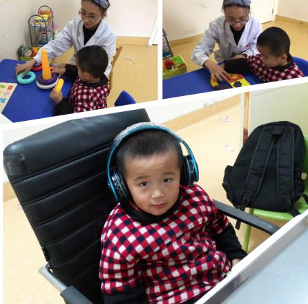 小程程在康复课上与康复师进行有趣的互动训练