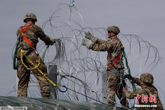 外媒:约800名移民在试图从墨西哥前往美国时被捕