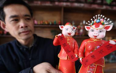"""山东沂南:面塑""""生肖猪""""送福迎新春"""