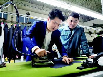 创新技术工艺,潜心做名制衣人