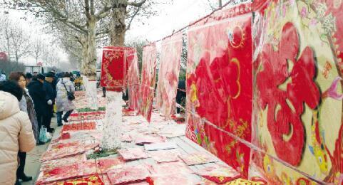别样春节:耳边鲜有鞭炮声 节日氛围依旧浓