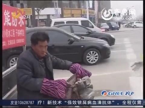 菏泽:未戴头盔隐患多 交警严查不松懈